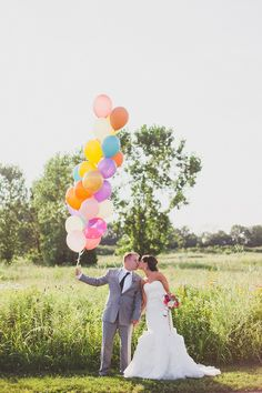 colorful balloons! photo by Kelly Maughan Photography http://ruffledblog.com/whimsical-columbus-wedding-with-a-colorful-palette #weddingideas #balloon