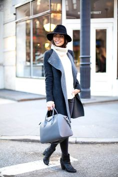 cozy layers and a cool hat to stay warm   Kat Tanita is wearing a white Loryelle Naven turtleneck from Theory