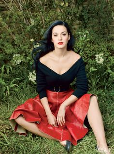 """When I am in between records, sometimes I doubt myself. I'll be like: Did I just get lucky, or did I mass-manipulate the world into thinking that seven songs were worth a number-one position?"" Perry reflects. Prada black Shetland wool sweater, red leather skirt, and belt. Repetto flats."