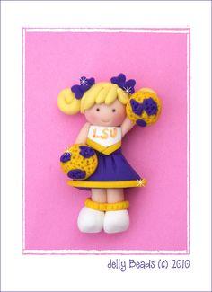 Polymer Clay Cheerleader bead, charm, bow center. $4.50, via Etsy.