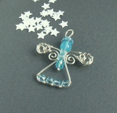 Turquoise Christmas angel ornament, blue handmade pendant, silver plated wire wrapped jewelry. $33.00, via Etsy.