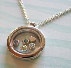 NEW  family birthstones locket necklace fill with by juliethefish, $35.00. MY FAVE JEWELERY DESIGNER!!  I <3 Julie the Fish Designs!!