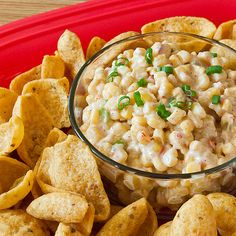 3 (11 oz.) cans of mexi or fiesta corn, drained (The kind that has peppers added to it) 3 green onions, diced 1/3 cup light mayonnaise 1/3 cup light sour cream 1 Tbsp lime juice 1 tsp garlic salt 1/2 tsp cumin 1/2 tsp chili powder 1 tsp sugar Frito scoops or other corn chips Combine all ingredients together in a large bowl and refrigerate for at least 1 hour.  Serve with Frito scoops.