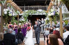 Happiness during the recessional!!  Groom pumping his fist!