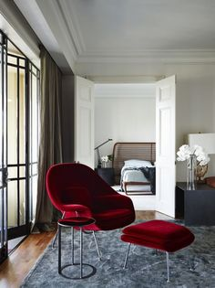 Red chair, foot stool, and side table