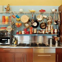 Vintage kettles and a wide-ranging assortment of pots and pans sit above kitchen cabinets from IKEA. Tagged: Kitchen and Cooktops. The Dwell Guide to Kitchen Design by Diana Budds from Sun Mun Way Cool. Above Kitchen Cabinets, Kitchen Shelves, Kitchen Storage, Kitchen Decor, Kitchen Organization, Organized Kitchen, Ikea Cabinets, Kitchen Ideas, Eclectic Kitchen