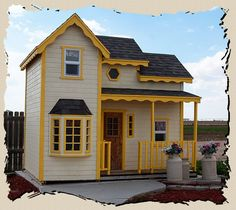 The Cottage is a traditional cottage style play house, with open rooms inside and a large front porch outside