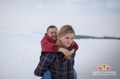 Snow too deep for small feet? That's what big sisters are for. #farmlife #SimpleGoodness