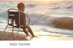 Boy sitting alone the chair by sea. People Photos