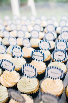 Individual wedding guest cupcakes - Image by Hannah May - Lace Justin Alexander Fishtail Gown for a family orientated classic wedding with Navy Suits, Pastel Bridesmaid dresses and a Mr & Mrs game during the speeches