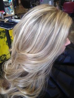 Cool blonde highlights over a light natural base.
