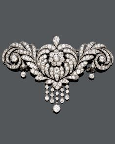 DIAMOND CORSAGE-BROOCH, ca. Designed as an open-worked flower with rolled-up leaves set with 1 pear-shaped diamond of ca. ct and numerous circular-cut diamonds, suspending 5 diamond-set pendants. Weight of the diamond ca. Antique Brooches, Antique Jewelry, Vintage Jewelry, Art Deco Jewelry, Fine Jewelry, Jewelry Design, Jewellery Box, Jewellery Shops, Diamond Brooch