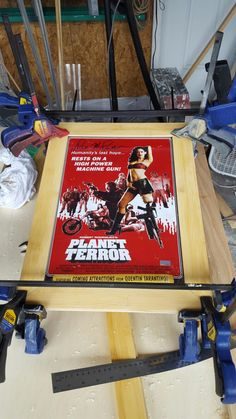 This is a frame i made for an autograph that was being given as a gift. It is made from left over bamboo flooring. The floor groove was left so that the plexi and picture could nicely slip into the piece. This frame was built around the photo