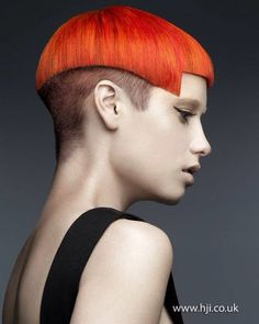 Art Coiffure #hairdare, edgy short haircut, orange red hair color on a very edgy and cool short hairstyle