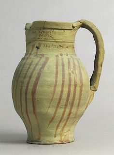 Date: 13th century Culture: French Medium: Earthenware with slip decoration Dimensions: Overall: 8 3/16 x 6 1/8 x 5 1/16 in. (20.8 x 15.5...