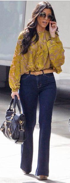 Kourtney in a bell bottom jeans