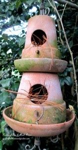 Terra Cotta Birdhouse - this one reminds me of something that would look at home in my Grandma's garden - terra cotta pots and saucers, stuffed with pinestraw - It's all about the birds