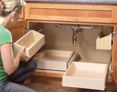 DIY Slide Out Drawers. This should be done under any  every kitchen sink! :: May have pinned this elsewhere already, but it's SUCH a good idea!.
