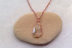 Wrap wire around a polished rock, shell or found item to make jewelry
