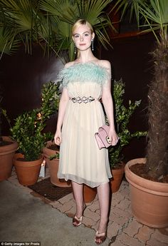 Elle Fanning looked in her element as she attended the Prada Private Dinner during the 70th annual Cannes Film Festival at Restaurant Fred L'Ecailler on Monday.