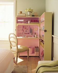 What may appear at first glance to be an unconventional armoire is actually a set of bookcases attached along one side. Opened, it's a compact, self-contained, innovative crafts or office nook. Closed, it's far more decorative than any tidied-up desk, without the slightest hint of its contents.