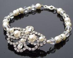 The Charlotte Bracelet €65/$88  http://www.julesbridaljewellery.com/collections/wedding-bracelets/products/vintage-style-rhinestone-pearl-bracelet-charlotte