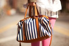 NYC Bag Stalking: The Coolest Carryalls On The Street #refinery29  http://www.refinery29.com/fashionable-handbag-pictures-new-york#slide2  Forget spots! We're seeing stripes for this bag from Little Black Bag. Photographed by Mark Iantosca
