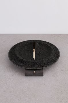 Clocks by Studio Formafantasma: Basalt, brass, lava sand
