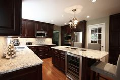 dark cabinets, light counters and silver hardware. Love this.