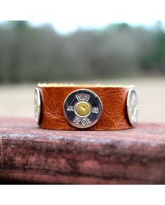 """Lizzy J's - 1"""" cuff bracelet made from cognac colored leather embellished with high gloss silver bullet casings."""