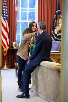 President Obama with his daughters.