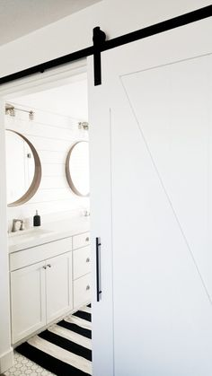Barn door in bathroom, stockholm Ikea mirros, shiplap above vanity, octagon and dot tile. White Rooms, White Walls, Sherwin Williams White, Trending Paint Colors, White Shiplap, Bathroom Paint Colors, White Mirror, White Barn, Ship Lap Walls