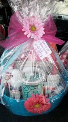 """Summer-themed thank you gift baskets I made for parent volunteers. Color themes were pink and aqua. Includes: pink towel, aqua sandals, polka-dot napkins, raspberry chocolate, aqua tumbler, Starbucks pink lemonade, Bath & Body soap and spritzer, and a framed class photo. Tied together with a little note: """"School is out, Summer is here, Thanks for all your help this year!"""""""