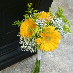 Bridesmaid flowers? But maybe with pale pink gerberas rather than yellow?