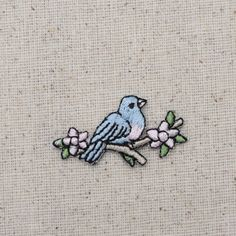 """Blue Bird Iron on Applique High quality, detailed embroidery applique. Can be sewn or ironed on. Great for hats, bags, clothing, and more! Size is approx. 1-1/2"""" x 1"""" or 3.81cm x 2.54cm"""