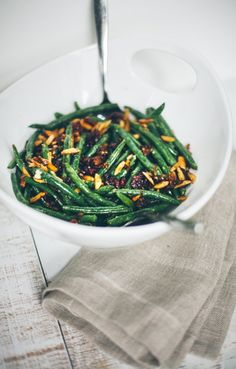 Green Beans with Shallots, Garlic, Toasted Almonds and Cranberries #recipe #sidedish #holidays #thanksgiving #christmas / Food Loves Writing