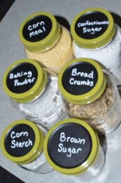 Mason jars for baking ingredients. makes a good seal. Using chalkboard paint to label the lids.