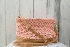 Light pink handcrafted bag, which made by 100% cotton yarn.  Its big space can carry all the essentials.  Perfectly matches with a natural cork strap with gold finishing touches.  The strap length is adjustable depending to the owner's choice.    The bottom is also made by natural cork and elegantly bound with the main cotton body of the bag.      Height: 20cm Length: 33cm  Width: 11cm  Price: 140€