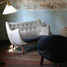 """""""Inspired by """"free art"""", Finn Juhl designed Poet for his own home in 1941. Today this sofa represents a part of Danish cultural history and modern furniture that exudes values that have more or less disappeared in these days of fleeting fancies."""""""