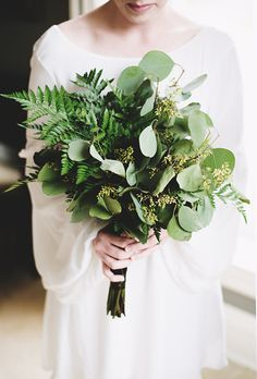 This greenery bouquet is dotted with bits of eucalyptus for a totally bohemian…