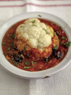 whole baked cauliflower with tomato & olive sauce Jamie Oliver Food Jamie Oliver (UK) Vegan if leave out the anchovies Cooked Vegetable Recipes, Vegetable Korma Recipe, Spiral Vegetable Recipes, Vegetable Dishes, Vegetarian Recipes, Cooking Recipes, Healthy Recipes, Vegetable Casserole, Cauliflower Vegetable