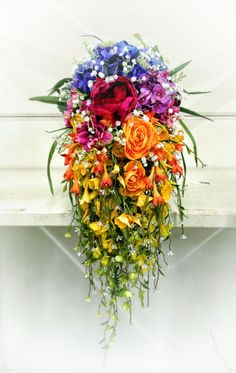 Rainbow Wedding Bouquet - I love this too and am interested in the waterfall...I love that the touches of white make it feel bridal even though its so unique