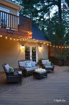 The deck is the perfect place to relax on a summer evening. We decorated this porch with colorful outdoor throw pillows, twinkling lights, lots of greenery--including ferns and boxwood wreaths--and of course a few icy libations. Even when the temperature is sky-high, this space is so inviting! {sponsored by HomeGoods}
