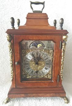 99p on eBay starts this Warmink 8 Day 10.2 Inch Burl Wood Bracket Clock With Rolling Moon Phase