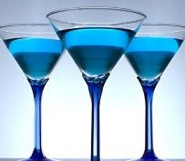 """""""Blue Christmas"""" Cosmo....Frost the rim of a chilled cocktail glass with sugar. In a cocktail shaker filled with ice combine Absolut Citron, Blue Curacao, grapefruit juice, and sugar syrup. Strain into cocktail glass. Garnish with a maraschino cherry."""