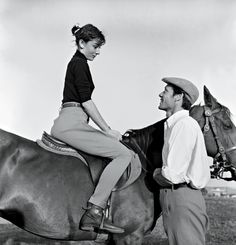 "Audrey Hepburn photographed with her husband Mel Ferrer by Pierluigi Praturlon, on a farm near Rome (Italy), during a training for the filming of ""War and Peace"", in May 1955. -Audrey was wearing Hermès pants."