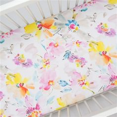 Crib Fitted Sheet in and Watercolor Floral by Carousel Designs.