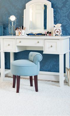 White vanity with the cutest blue chair