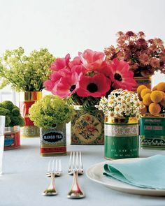 With their beautiful ornamentation and lettering, biscuit and tea tins bring old-fashioned charm to a bridal shower and perfectly fit in with a tea theme. New or vintage, the containers are inexpensive and easy to find at specialty food stores, tag sales, and online auctions. Test tins to make sure theyre watertight before filling with single-flower arrangements. If any do leak, use plastic bags as liners. Choose an array of flowers in the color palette of the shower or wedding.