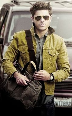 I'm not a Zac Efron fan, but he just look so good in this picture....I just love well-dressed men.